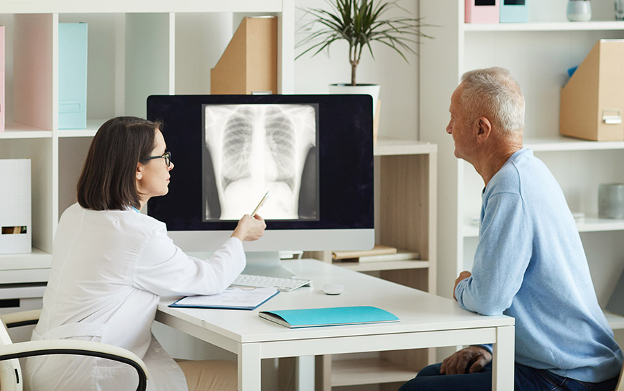 Doctor Showing X-Ray